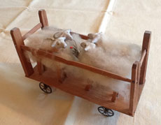 Sheep in Wooden Cart
